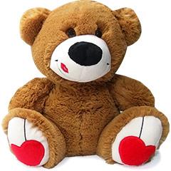 Romântico ursinho de pelúcia com beijinho na face e coração nos pés.