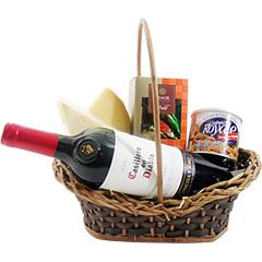 Um vinho tinto importado, castanhas e dois tipos diferentes de queijo fazem dessa cesta um presente delicioso. Para arrematar, deliciosos pequenos chocolates da doceria Munik.