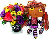 Impactante bonequinha Monster com flores coloridas