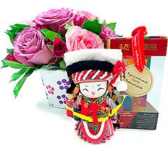 Bai não tem limites.... Sua CRIATIVIDADE lhe trará muitas alegrias. Acompanha um arranjo floral com rosas.