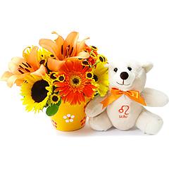 Um delicado e surpreendente arranjo de flores mistas em tons de amarelo e laranja que acompanha o ursinho exclusivo leonino, celebrando a generosidade, nobreza e criatividade tão características desse signo.