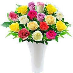 Quinze maravilhosas e coloridas rosas nacionais em vaso de acrílico.