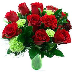 Delicada composição com rosas tipo exportação vermelhas e cravos vermelhos e verdes com folhagens e base de acrilico